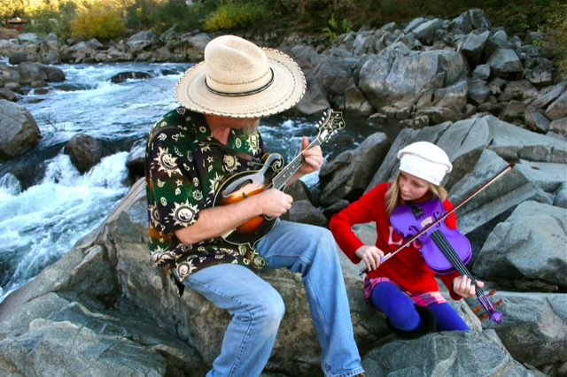 Joe and Hattie Craven jam, along the banks of the American River, at RiverTunes.